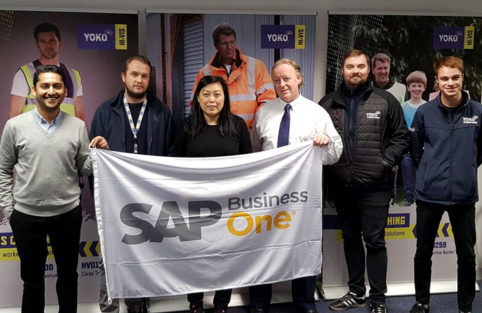 Yoko Int team holding SAP flag